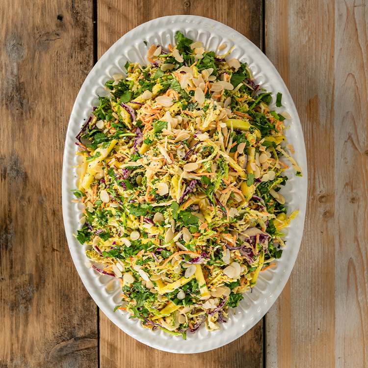 Lightly Curried Slaw With Savoy Cabbage Fresh Mango Toasted Almonds Basil Wholefoods